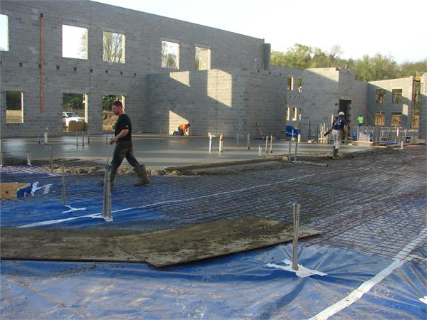 Pouring concrete in Kindergarten section