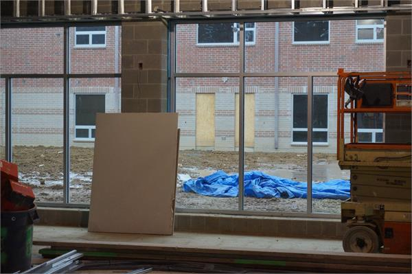 Looking out the elementary cafeteria.  The lighter colored brick are the kindergarten rooms.