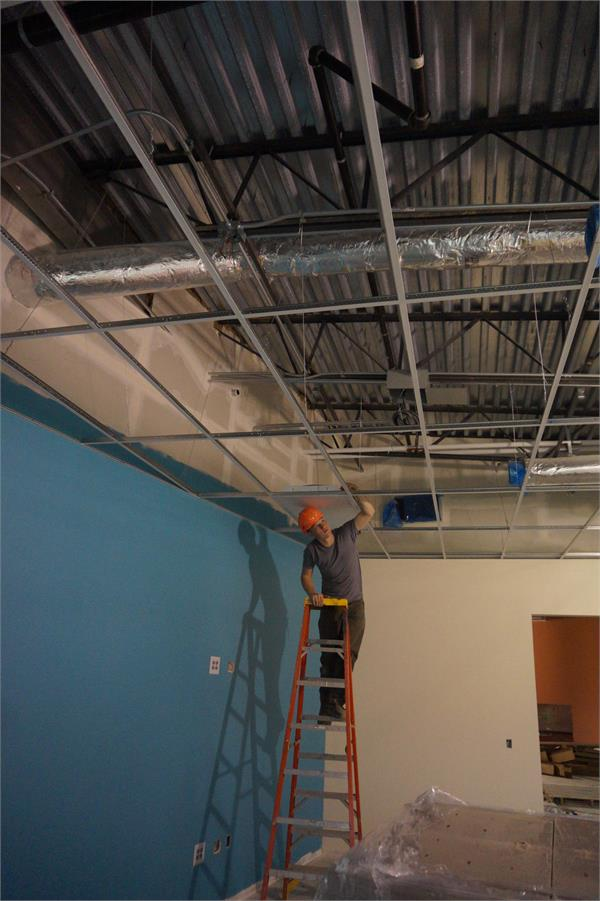Installing the suspended ceiling and lights in the elementary area