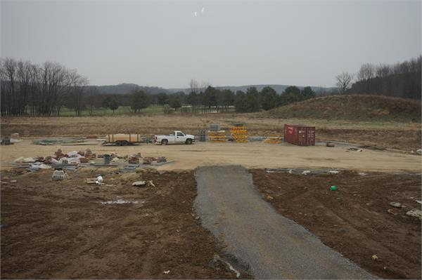 View from the 5th grade learning area.  Large mound of dirt is future soccer field with tennis courts to the left.