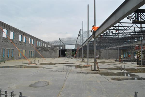 Elementary wing  with concrete floors an steel going up